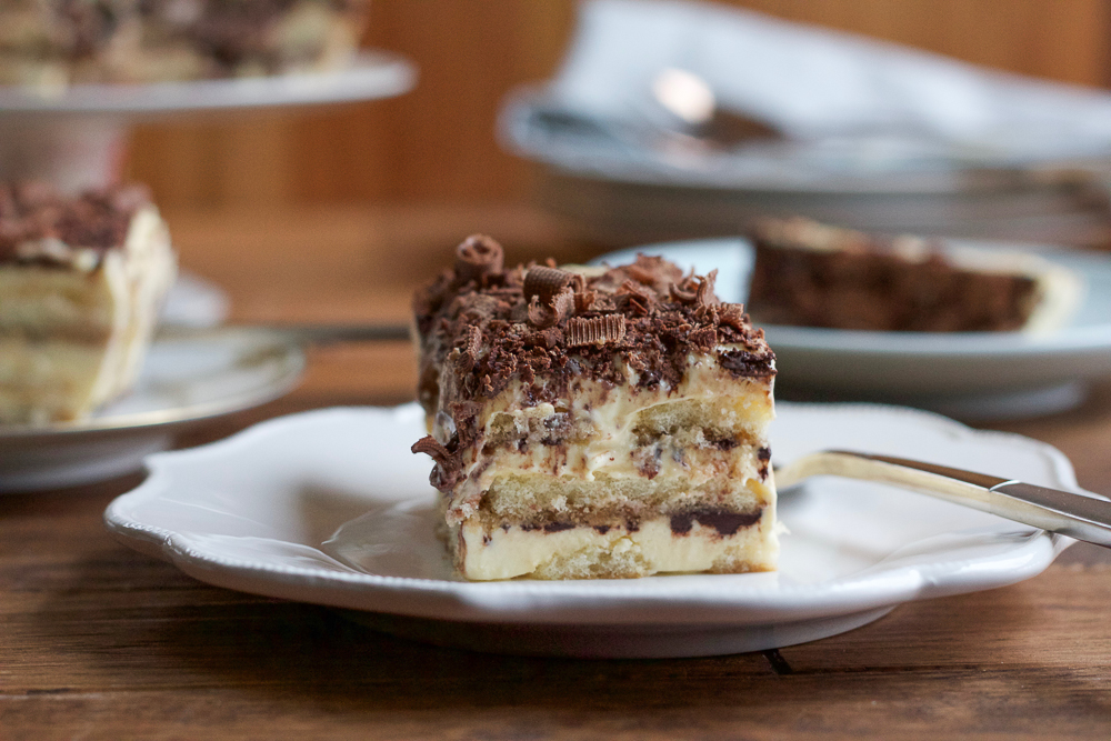 Rich, creamy and delicious Tiramisu. Mascarpone custard layered with cocoa powder and brandy and espresso soaked ladyfingers. EASY to make and amazing!