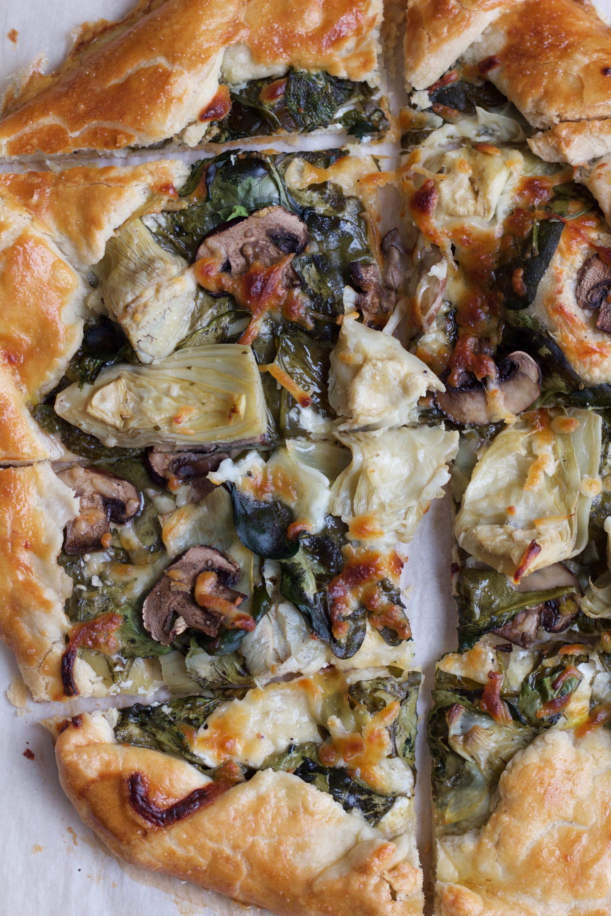 Spinach Mushroom and Artichoke Galette. So delicious and easy to make! Impress your family and friends with this savory tart. It's a perfect recipe for Easter Brunch!