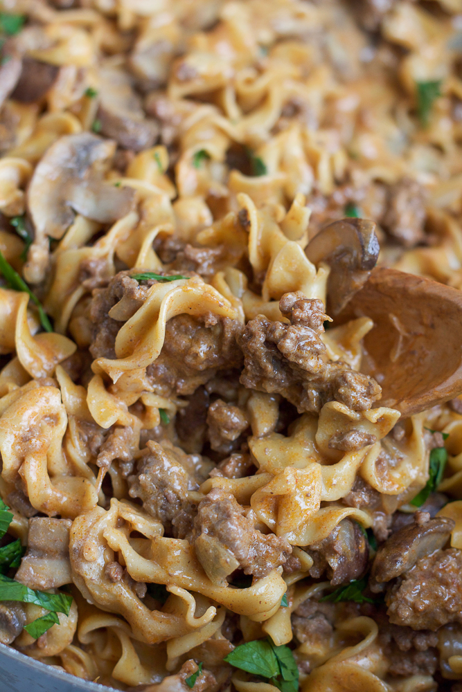 Simple Beef Stroganoff in a pot with a wooden spoon.