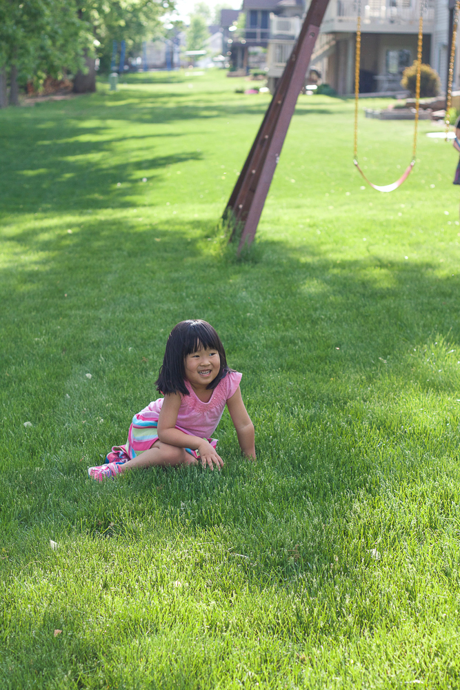 A child playing in the grass.