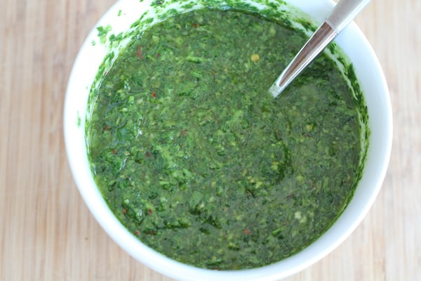 A bowl of chimichurri sauce.