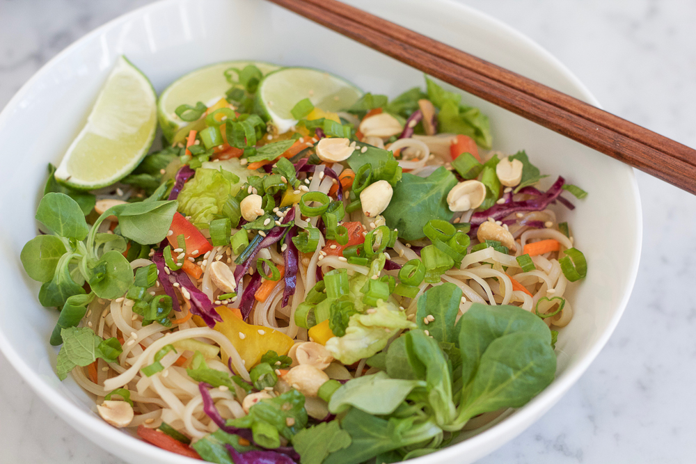 Spicy Korean Noodle Salad! Light, fresh and filled with veggies and mache rosettes! Make it spicy or non-spicy! This is the perfect summer meal and only takes about 15 minutes to make!