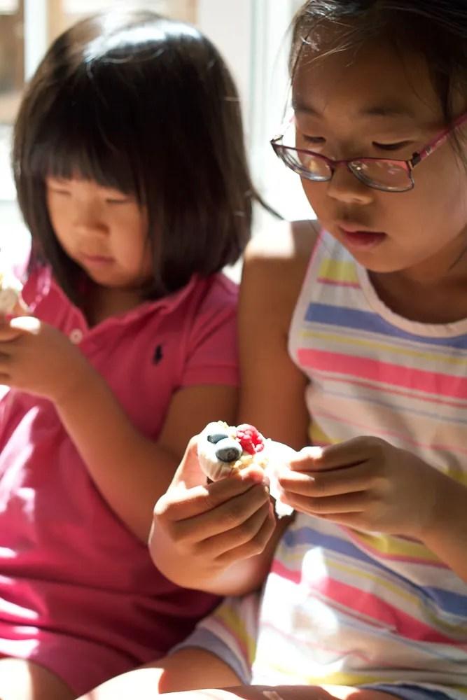 Kids eating Frozen Berry Yogurt Bites.