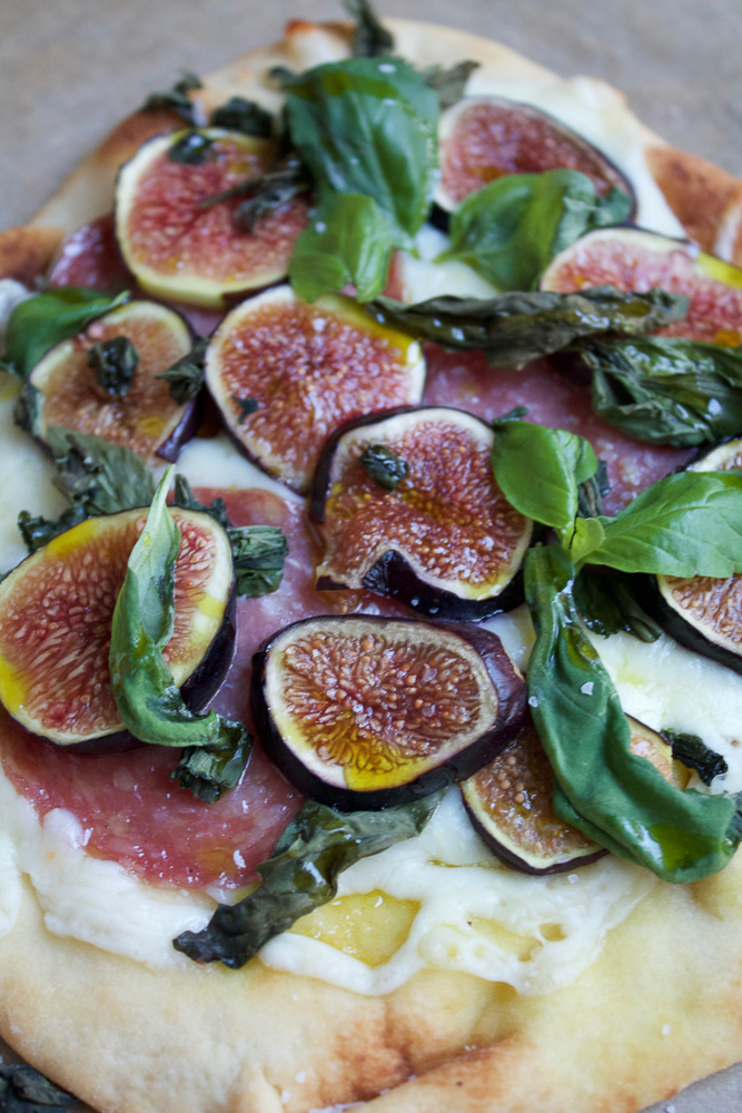 Fig Prosciutto Pizza! Super easy to make and delicious Fig Prosciutto Pizza on flatbread or naan bread. Take full advantage of fig season and make this pizza! It's so good!