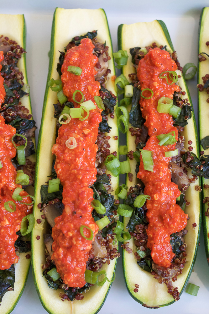 A row of Quinoa Stuffed Zucchini Boats.
