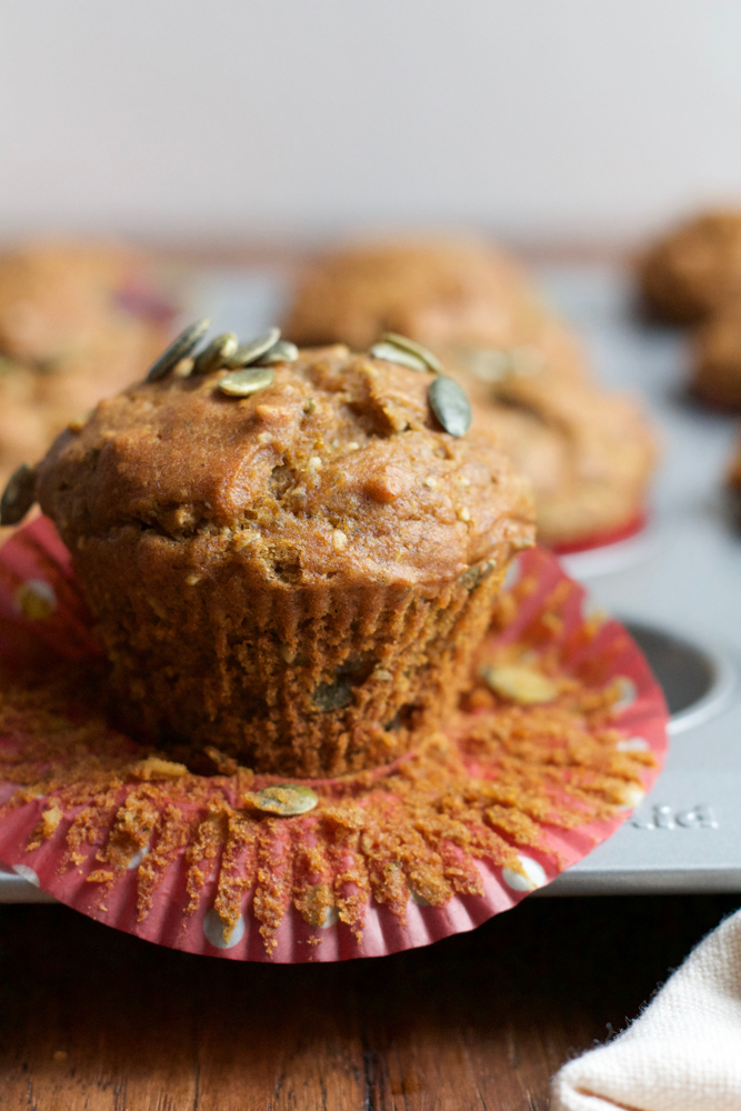 Double Pumpkin Pie Muffins!! Delicious muffins filled with pumpkin, bits of pepitas and just the right amount of pumpkin pie spice! These are a must bake in the fall and a delicious way to start your day!