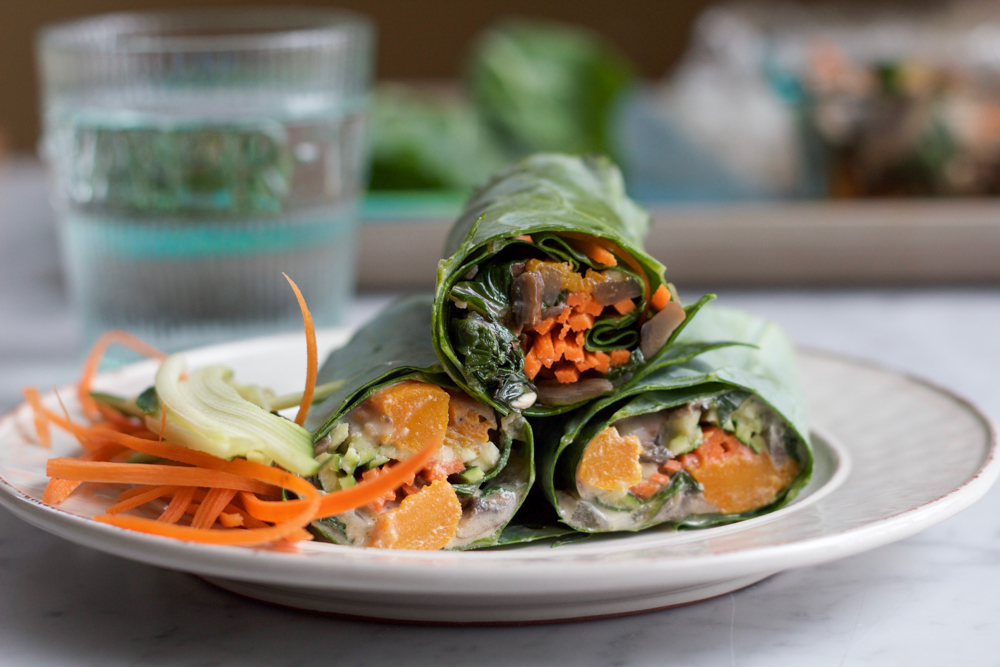 Roasted Butternut Squash Collard Wraps! A healthy and delicious way to enjoy some of your favorite veggies! Try them with homemade tahini sauce, or my spicy peanut sauce! Either way, make these wraps!