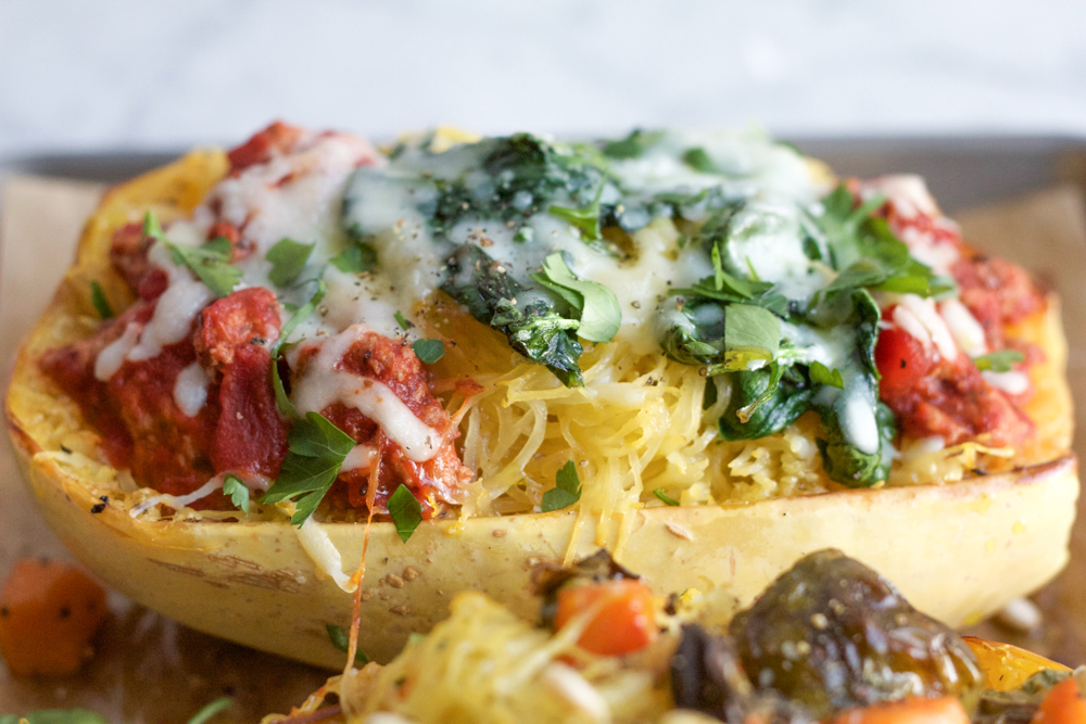 Spaghetti Squash Lasagna! So good and delicious and because one half squash is less than 400 calories, you won't feel guilty at all for eating this entire thing!