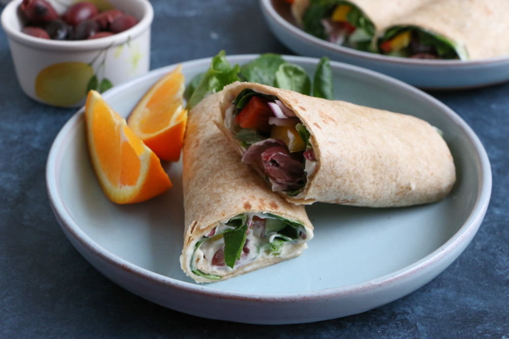 Mediterranean Veggie Wraps made with fresh veggies like spinach, bell peppers, cucumbers and red onions, and Hellmann's Organic Mayonnaise. So easy to make and delicious! #ad