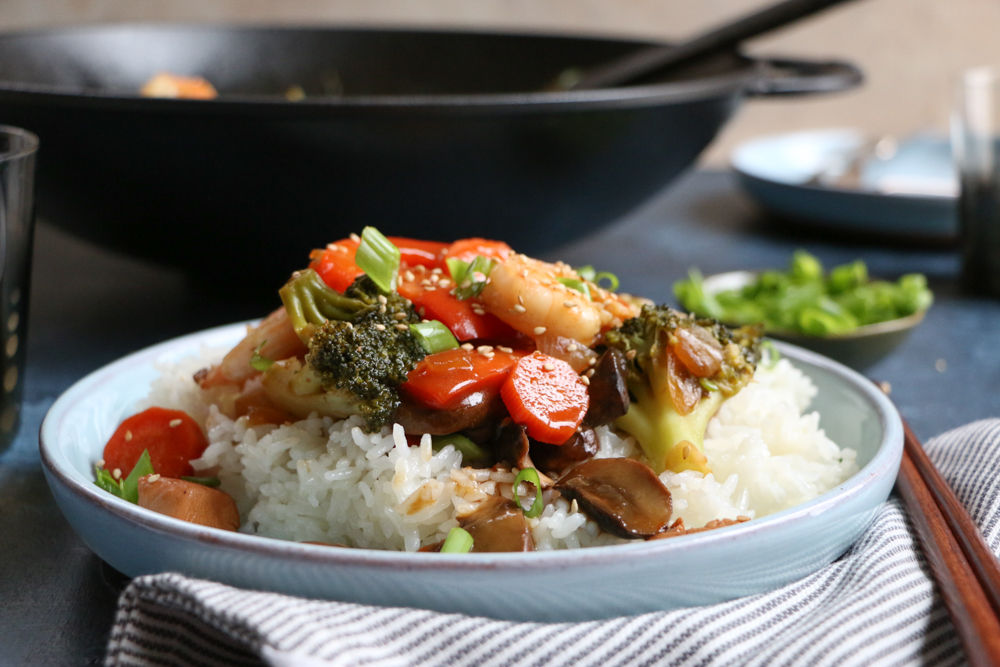 Learn how to make stir fry at home! So delicious and easy to make! This Chicken Shrimp Stir Fry is packed with fresh veggies, chicken and lots of shrimp! This is the most requested recipe from my kids!