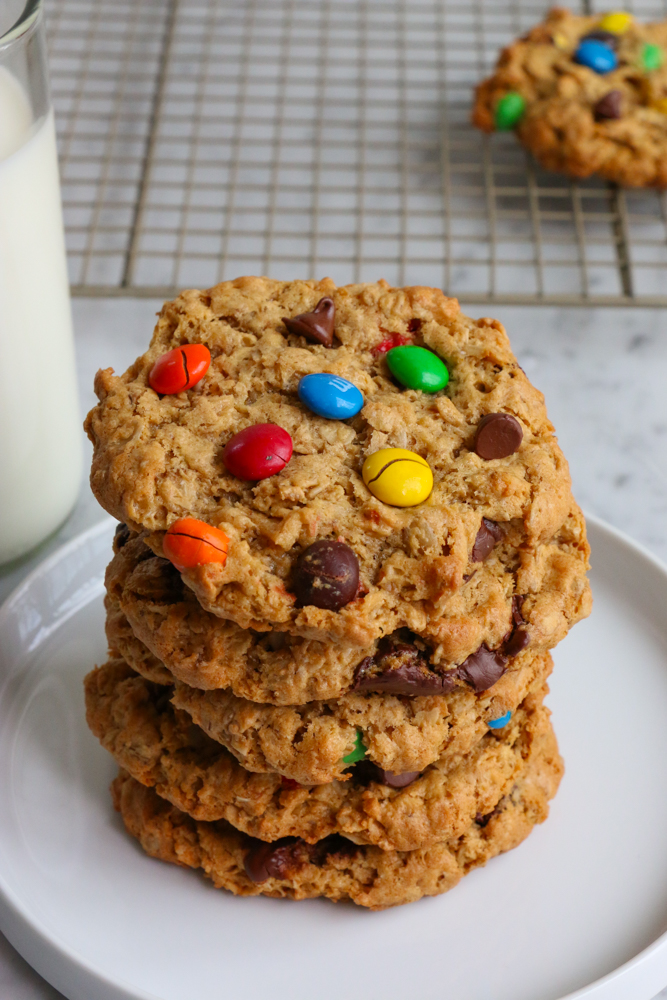 Gluten Free Monster Cookies! Thick, chewy and delicious! These are the perfect cookies to enjoy with a tall glass of milk!