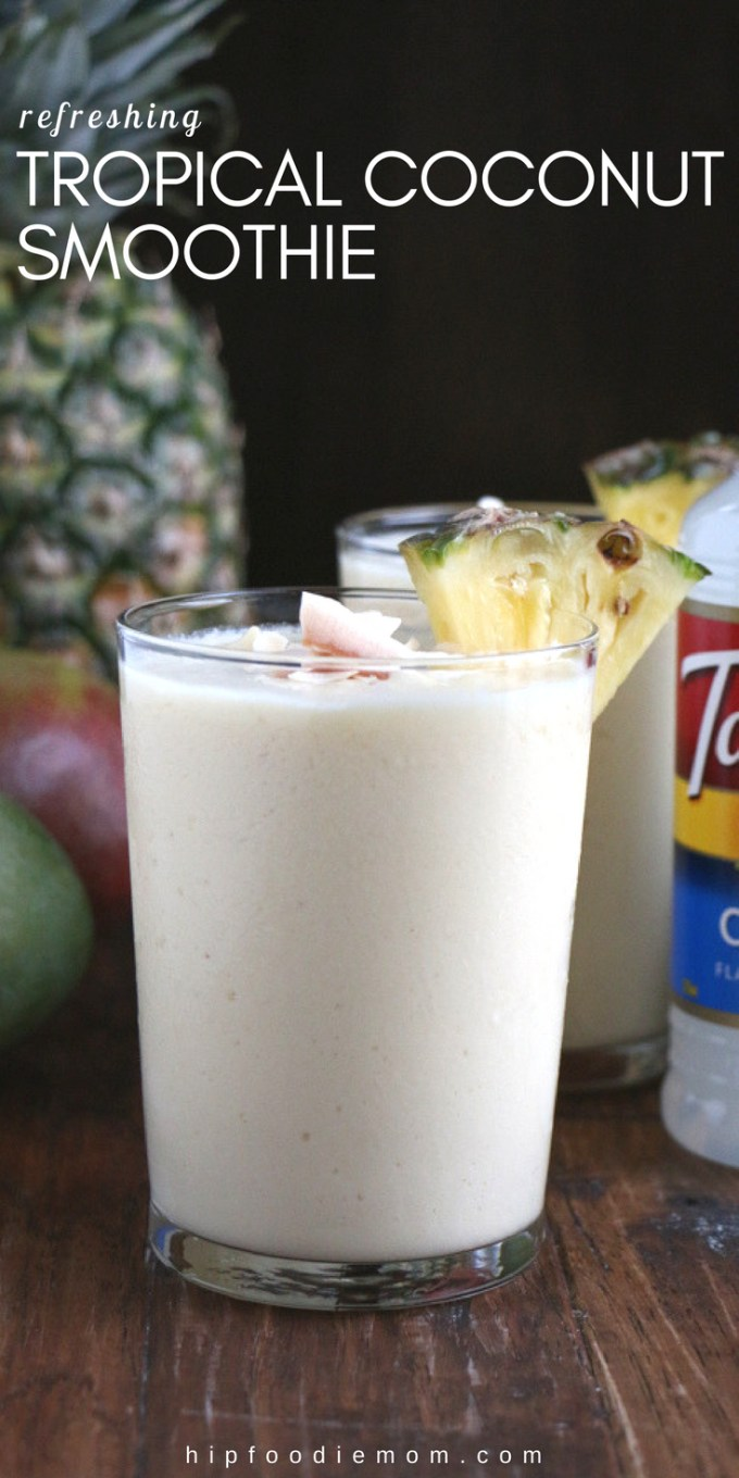 Refreshing Tropical Coconut Smoothie made with Torani Coconut Syrup, frozen mangos, pineapples and more! Let this smoothie transport you! #tropicalsmoothie #coconutsmoothie #smoothierecipe #mangosmoothie #pineapplesmoothie #breakfastsmoothie #coconut