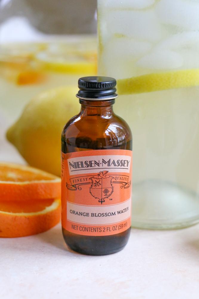 A bottle of orange blossom water for Orange Blossom Lemonade.