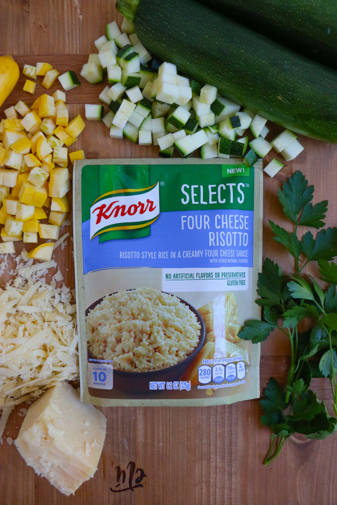 Chopped vegetables, cheese, herbs, and a package of risotto for four cheese risotto.