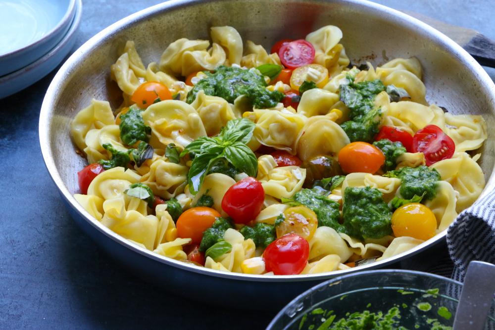 A skillet of Summer Tortellini Pasta Salad.