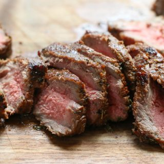 slices of medium rare steak marinated with homemade steak marinade