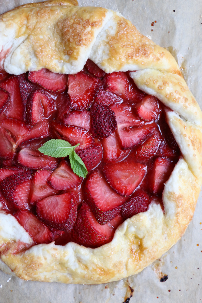 Strawberry Galette on parchment paper.