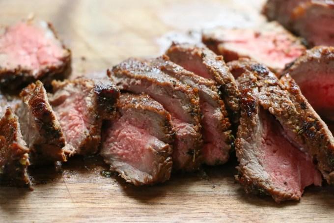 slices of medium rare steak marinated with homemade steak marinade