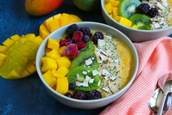 Delicious Mango Smoothie Bowl! A great way to start your morning! Packed with mangos, bananas and more! One cup of mangos provide 100% of your daily vitamin C, 35% of your daily vitamin A and 12% of your daily fiber!