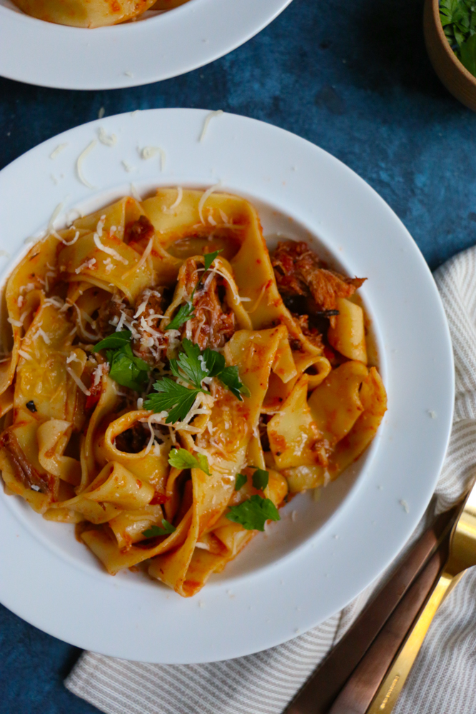 Delicious Pork Shoulder Ragu with pappardelle pasta! Takes some time but it's well worth it! Your kitchen will smell amazing and your family will be asking for seconds! I hope you give this recipe a try!