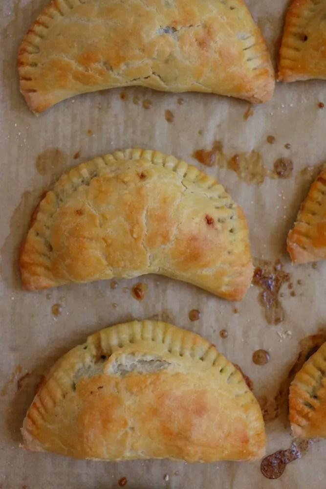 Tofu Empanadas! Stuffed with Nasoya's marinated baked tofu, spinach, zucchini, mushrooms and more, these flavorful and savory vegetarian empanadas are so good!