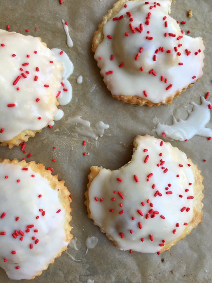 Raspberry Pop Tarts! Make your kids' favorite right at home! Made with an easy pie dough and delicious cream cheese glaze, your family is going to love these!