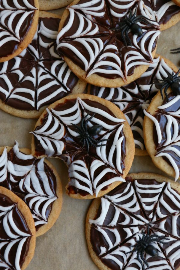 Spider Web Sugar Cookies made with whole wheat flour! These cookies have a silky and smooth chocolate ganache and white icing! Perfect for a Halloween party!