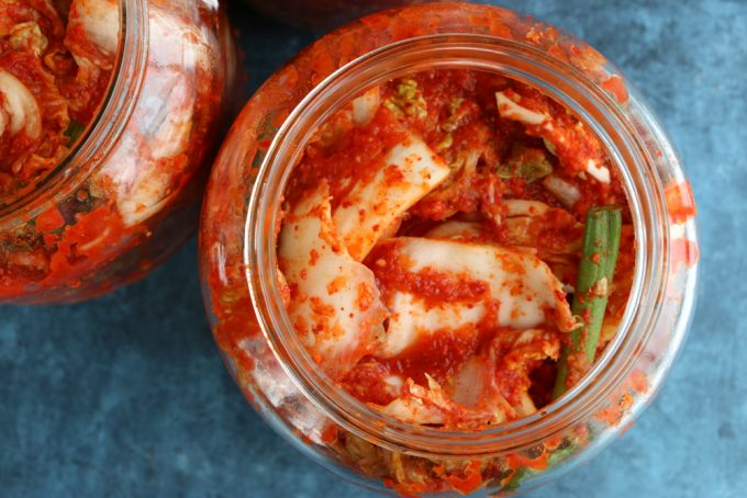 looking down into jar of homemade kimchi