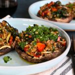 Vegetarian Stuffed Portobello Mushrooms! Packed with sautéed vegetables, farro and seasoned with Tony Chachere's No Salt Seasoning Blend! You're going to love these!