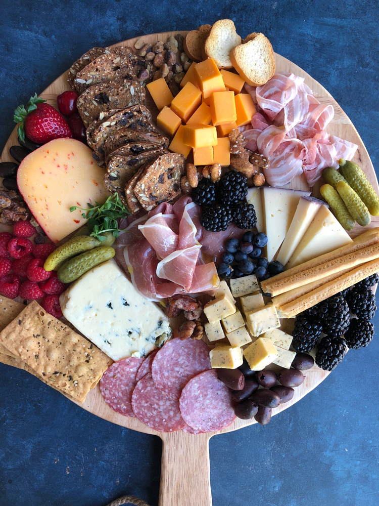 How to make the perfect cheese board! Entertaining can be so easy simply by putting together a cheese and charcuterie platter.