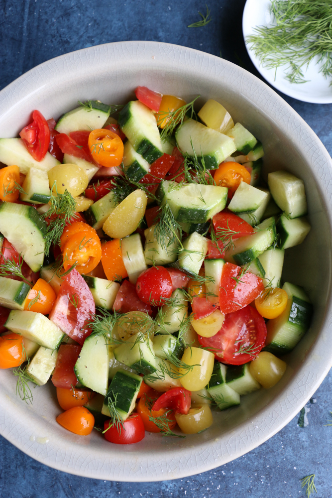 Overhead photo of a bowl of Super Simple Cucumber Tomato Salad.