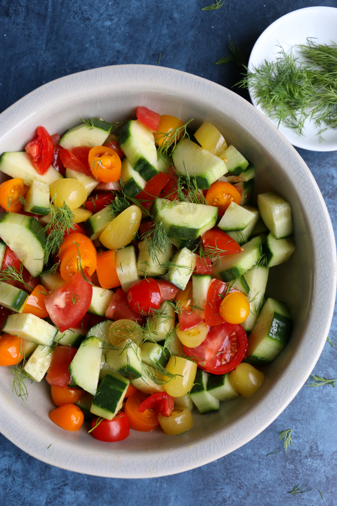 Photo of a bowl of Super Simple Cucumber Tomato Salad.