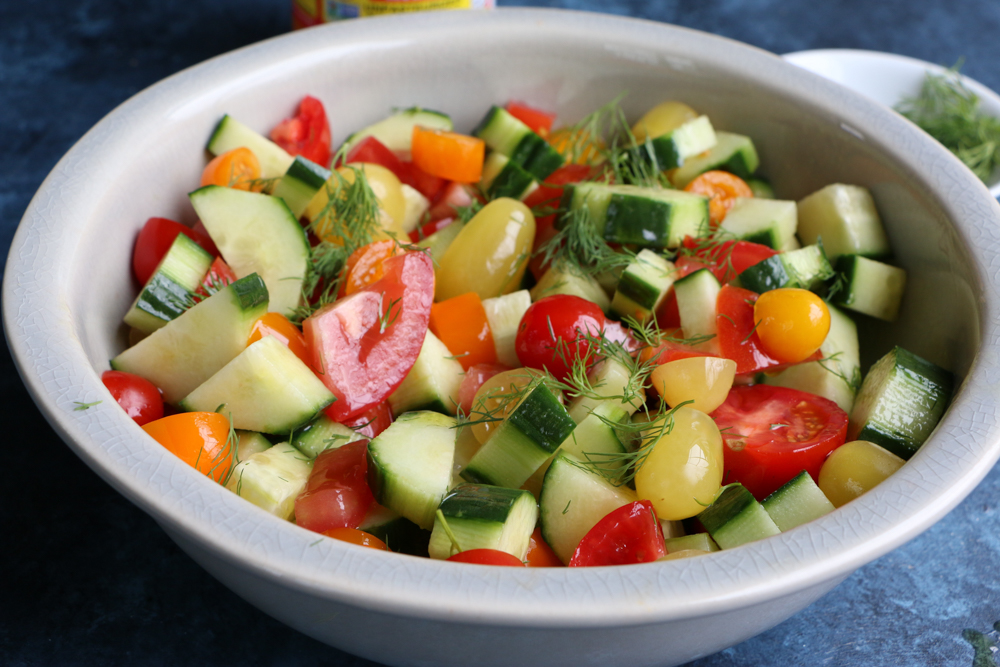 A bowl of Super Simple Cucumber Tomato Salad.