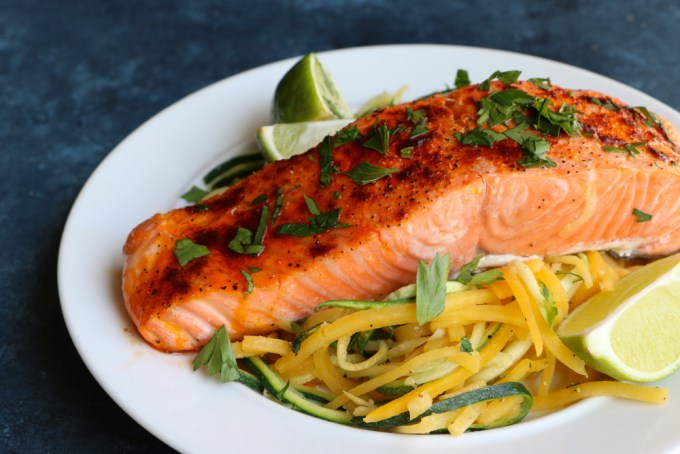 Baked Salmon with Spiralized Veggies! This is one of my go-to meals because it's so easy, quick and delicious! Rich in Omega-3 Fatty Acids and a great source of protein, you should definitely go pick up some salmon today!