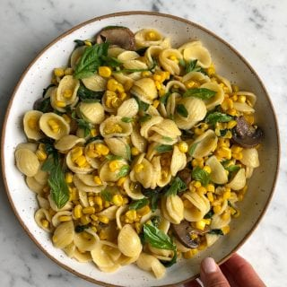Orecchiette With Corn and Spinach!! Whether you are using up your last sweet summer corn or using frozen corn, this simple, easy and absolutely delicious pasta comes together in no time at all!