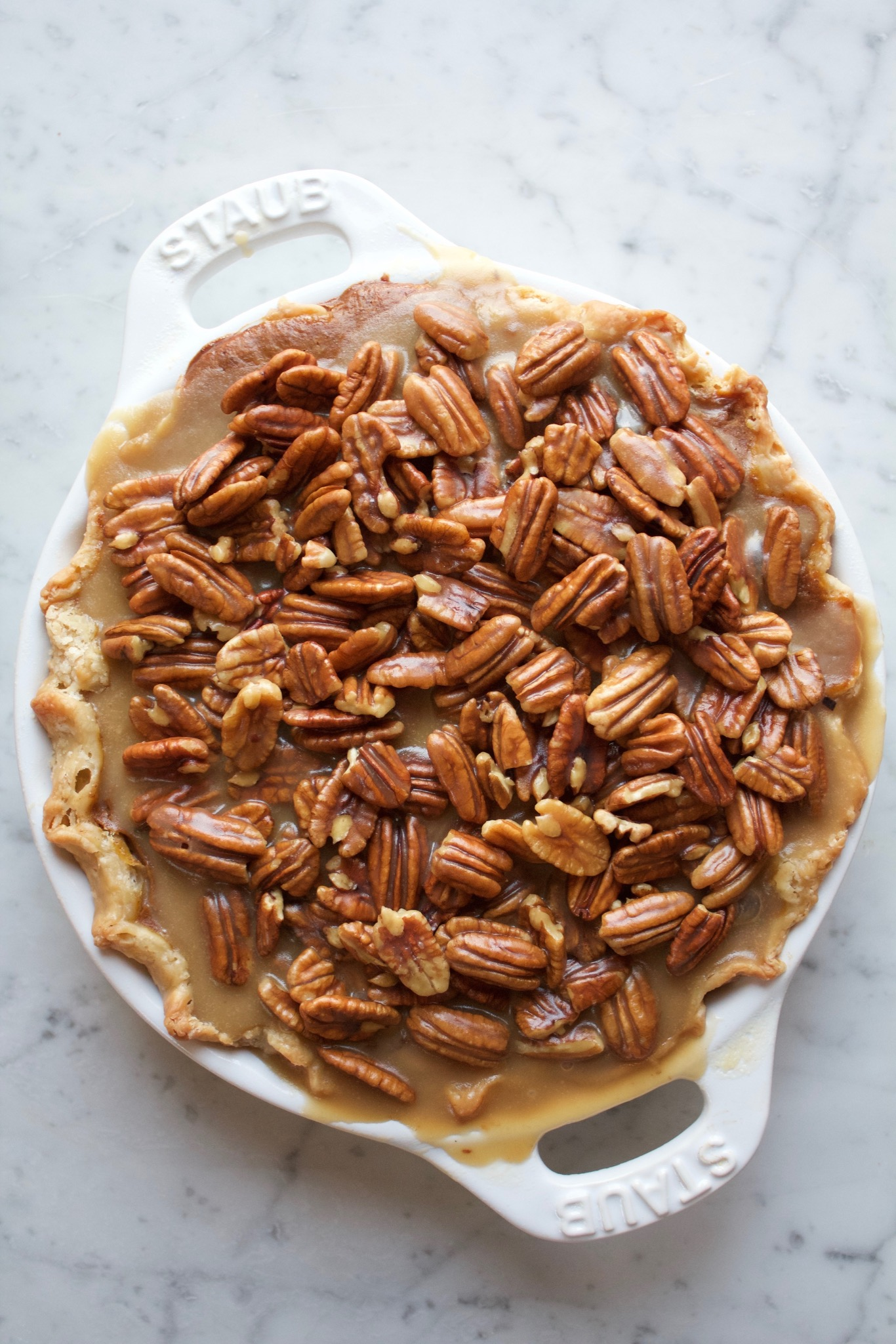 Pecan Apple Pumpkin Pie! This is the ultimate Thanksgiving pie (three pies in one!) with a layer of spiced apples, pumpkin pie filling and finished off with caramelized pecans. It's delicious!