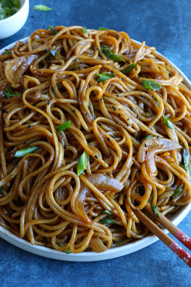 Lo Mein (vegetarian) on white plate with chopsticks