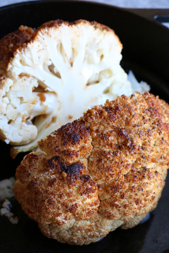 Whole Roasted Cauliflower with a light, spicy Asian dressing. Forget the side dish, this could be the star of your dinner table! This is incredible!