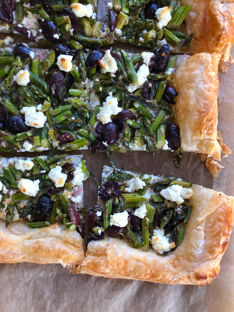 Asparagus Goat Cheese Tart! From America's Test Kitchen and Cook's Illustrated new cookbook, Vegetables Illustrated! Light, flakey and buttery and so much flavor from the asparagus, olives and goat cheese! You're going to love this!
