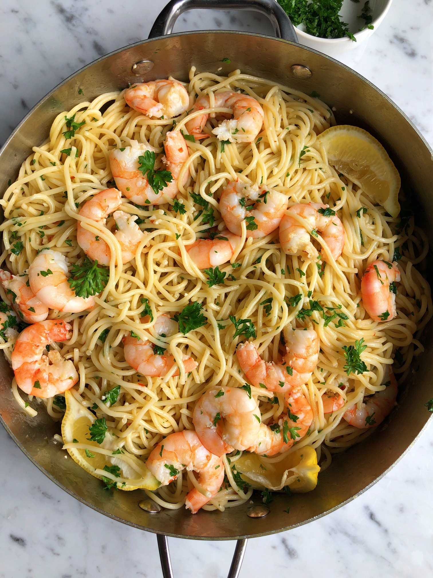 Shrimp Scampi with Pasta!! A simple garlic, white wine and butter sauce that is absolutely delicious! Add pasta or grab some crusty bread!