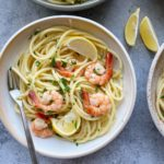 Shrimp Scampi with Pasta!! A simple garlic, white wine and butter sauce that is ready in minutes and is absolutely delicious! Add pasta or grab some crusty bread to soak up and devour this sauce! We hope you try this!