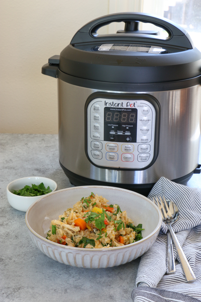 Instant Pot Chicken and Rice. So easy and delicious and made in a fraction of the time with my Instant Pot! You'll want to put this recipe into your family's meal rotation today!