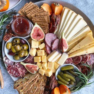 Perfect for parties, the holidays and family gatherings - Making a cheese board is an entertaining essential! #cheeseboard #cheeseplate #holidayparty #hipfoodiemom