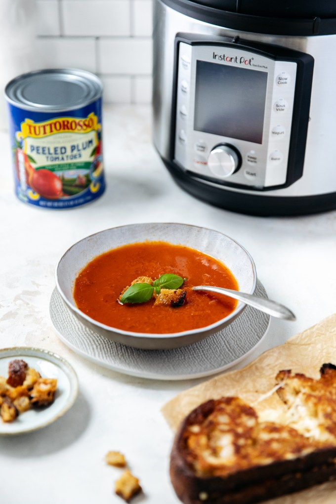 Instant Pot Tomato Soup! Classic and delicious Tomato Soup made in a fraction of the time! Rich, creamy and oh so delicious using Tuttorosso Peeled Plum Tomatoes! We hope you try it!