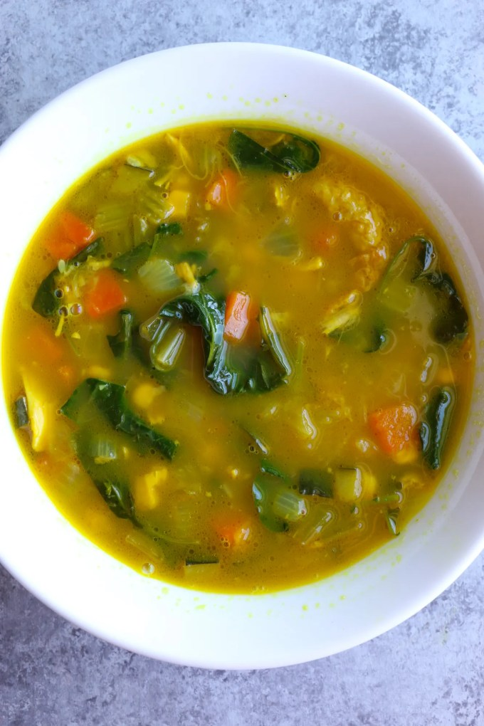 Immunity Boosting Turmeric Chicken Soup with carrots, onions, celery, zucchini, corn, kale and spinach. Not only is this soup packed with vegetables, but also immune system boosters like turmeric, ginger, garlic and spinach! You've got to try this!
