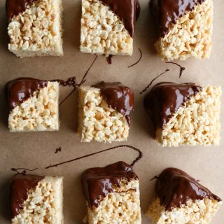 Peanut Butter Rice Krispie Treats with Chocolate! These are so easy to make! Mix it up by adding peanut butter and dipping into chocolate.
