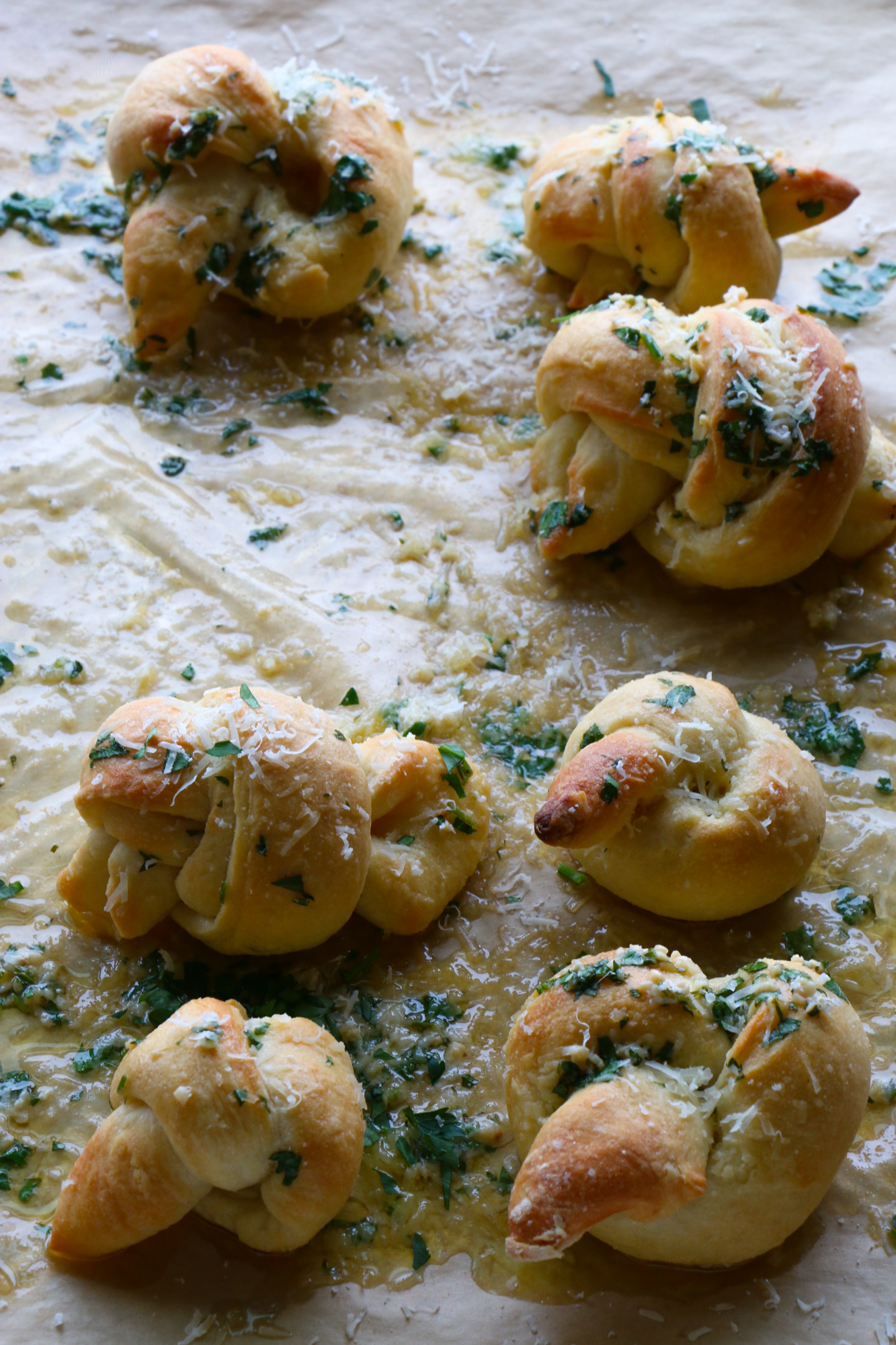 How To Make Parmesan Garlic Knots! So delicious and easy to make! Buttery, garlicky, cheesy goodness. You won't be able to resist these!