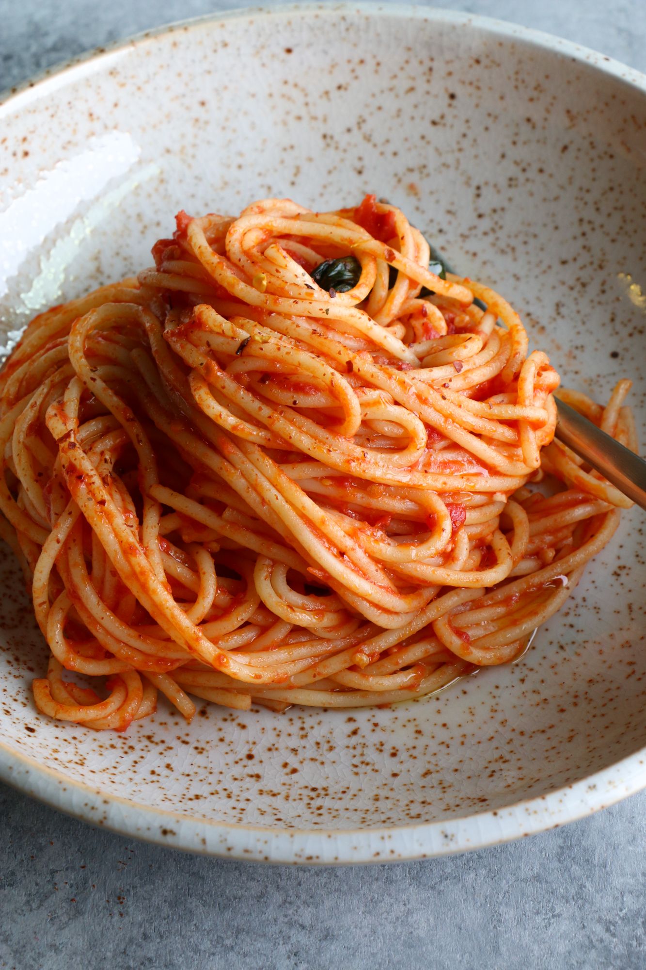 The Best Spaghetti Ever and so easy to make! This recipe uses garlic, olive oil, canned San Marzano tomatoes, butter and more. Make this!