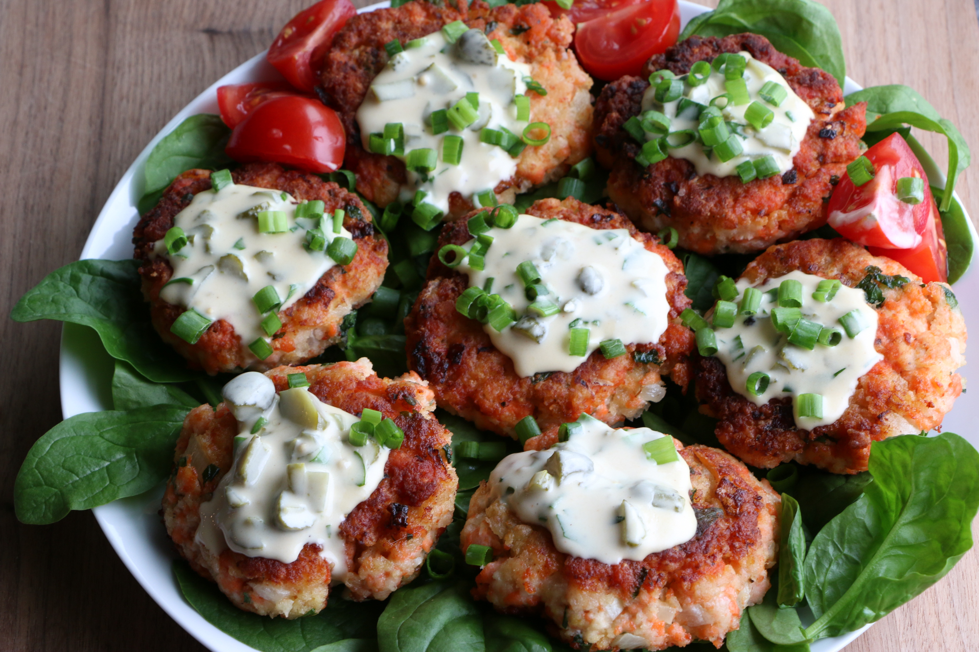 How To Make Salmon Cakes! Delicious and so easy to make! Topped with a homemade tartar sauce, we really hope you try this recipe!