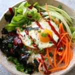 How To Make Breakfast Bibimbap! Filled with just some raw veggies and topped with a fried egg, this is one breakfast you will love!